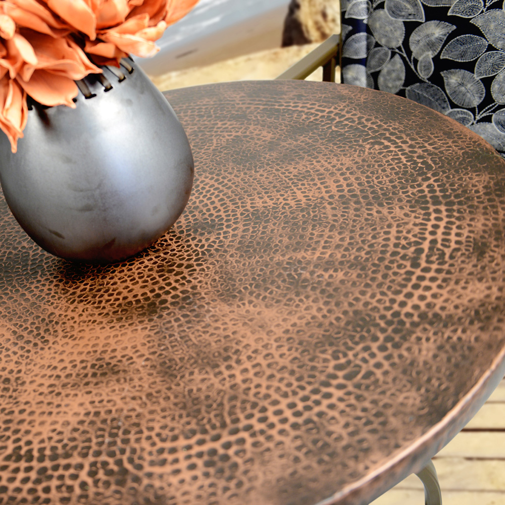 Hammered metal 52 round dining table with angled legs for Table 52 botswana